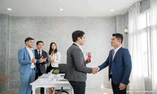 Handshake Between Employees