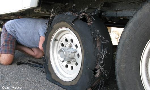 Man working on flat tire