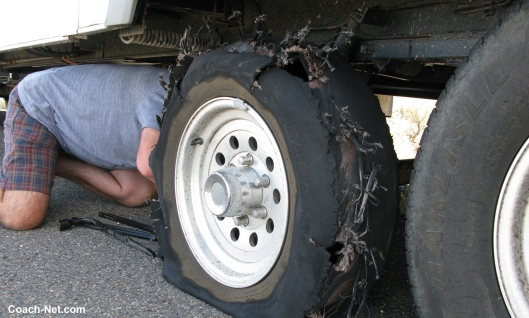Man working on flat tire
